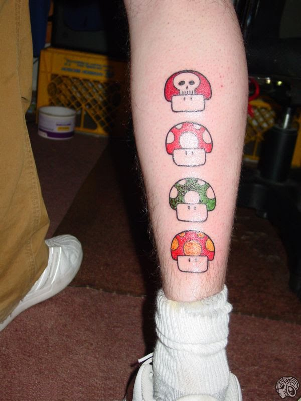 Leg tattoos tattoo art gallery for Mario mushroom tattoo